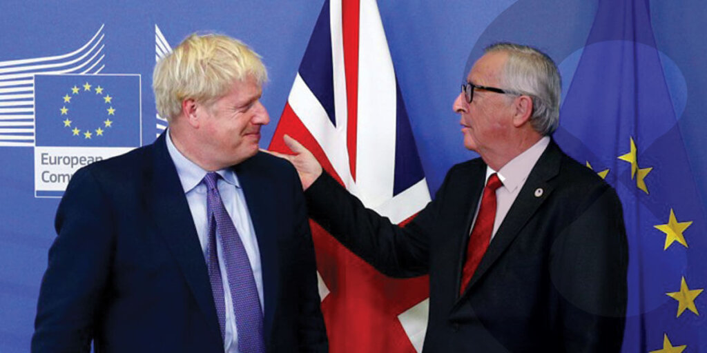 Boris Johnson and Jean-Claude Juncker meet in front of the flags of the UK and the EU