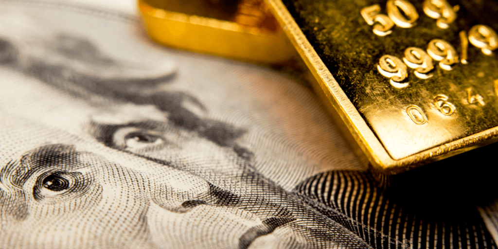 A USD banknote and a Gold bar