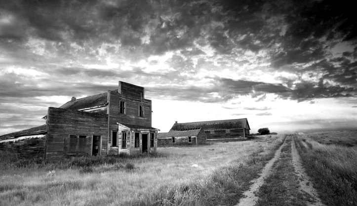 Black-and-white photo of abandoned buildings