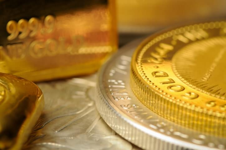 A collection of gold and silver coins and bullion.