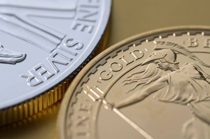 Photo of gold and silver bullion coins side by side.