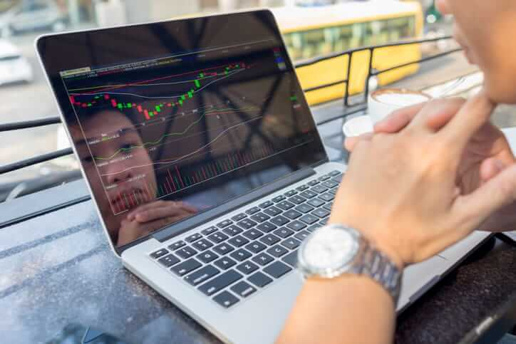 Trader watching the change of stock market on laptop